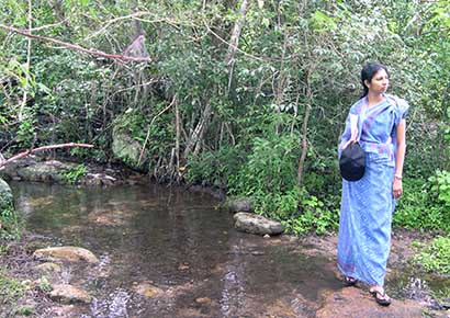 Woman standing at a stream